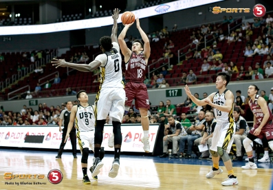 UP star Paul Desiderio makes a two over UST's much taller Steve Akomo