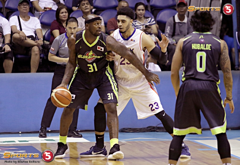 Globalport's Murphey Holloway guarded by NLEX' Aaron Fuller