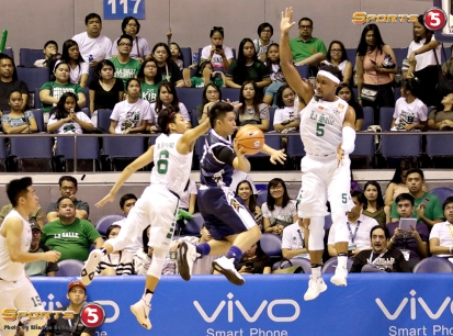 NU's wily Jayjay Alejandro draws the defense from Ricci Rivero and Abu Tratter before passing the ball