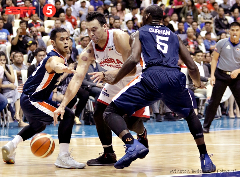 _S1A2168 Meralco's Garvo Lanete and Allen Durham harass Ginebra's Greg Slaughter