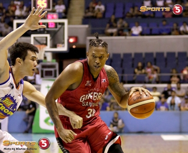 _S1A7293 Ginebra's Joe Devance drives hard on TNT's Troy Rosario