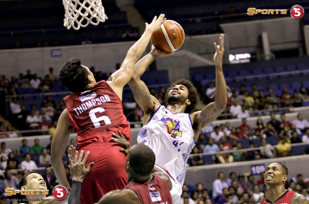_S1A7518 TNT's Glenn Rice Jr smiles as he fades away from Scottie Thompson