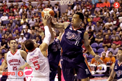 _S1A8623 Meralco's Chris Newsome leaps high for the rebound