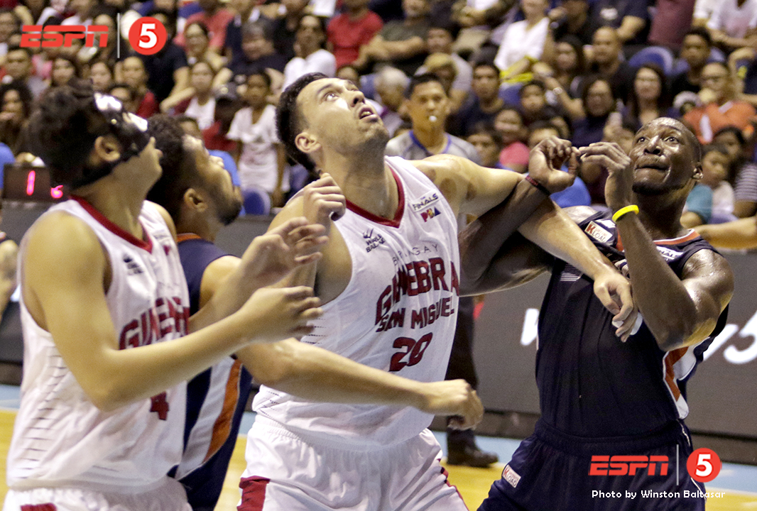 _S1A8763 Ginebra's Greg Slaughter battles for the rebound with Meralco's Allen Durham