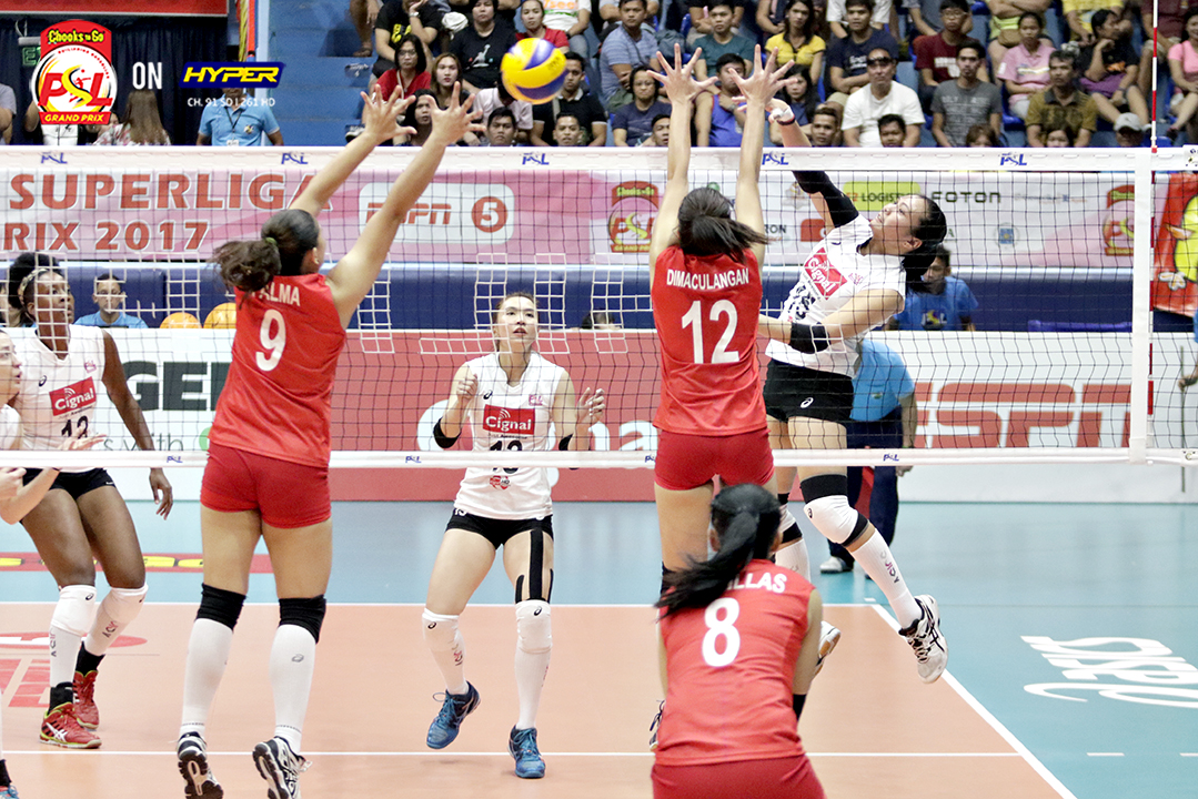 _S1A3883 Cignal's Jovelyn Gonzaga spikes one in past Petron's Rhea Dimaculangan