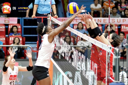 _S1A4104 Cignal Middle Alexis Matthew battles with Petron's Mika Reyes at the net