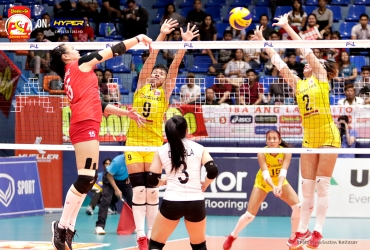 _S1A7560 Cignal's Honey Rose Tubino spikes through F2's Kim Fajardo and Aby Marano