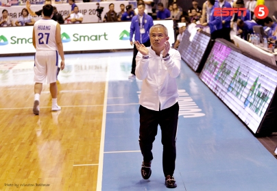 Coach Chot Reyes applauds a Gilas play