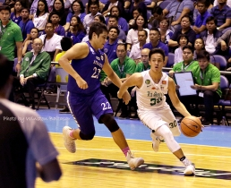 Andre Caracut drives on Raffy Verano